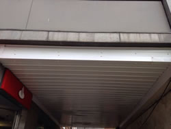 Cladding of an underpass using preformed sheeting.